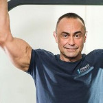 Charles Poliquin talking about thick arms, fat grips